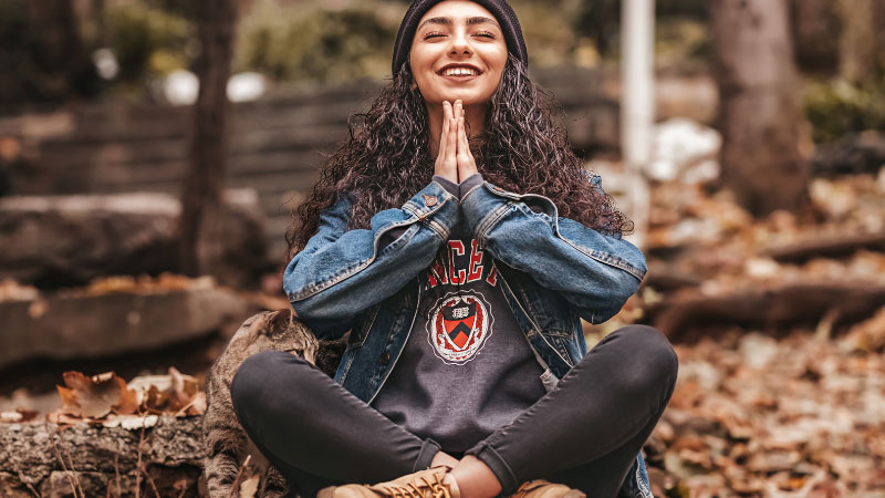 Woman smiling whilst meditating