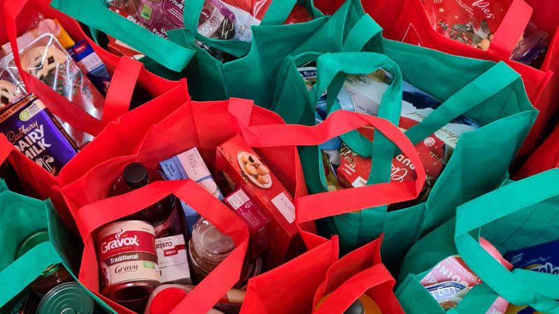Groceries in red and green shopping bags