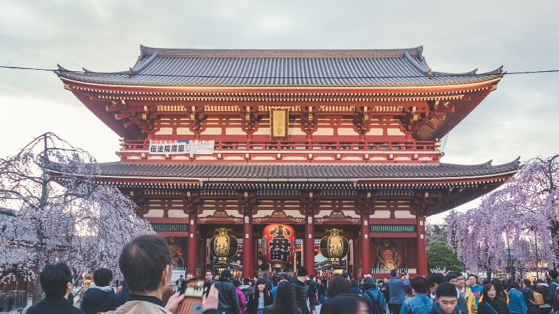 a crowd of people in front of sensoji temple in asakusa, japan