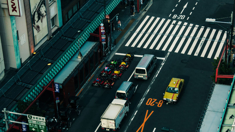 Go karts stopping at traffic lights in tokyo