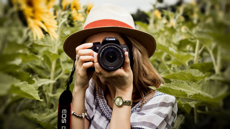 Woman taking photograph with a DSLR camera