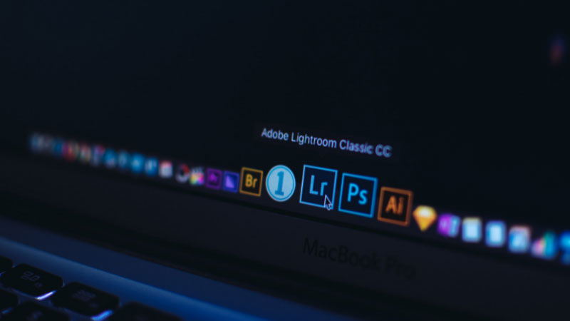 Lightroom and photoshop symbols on a macbook