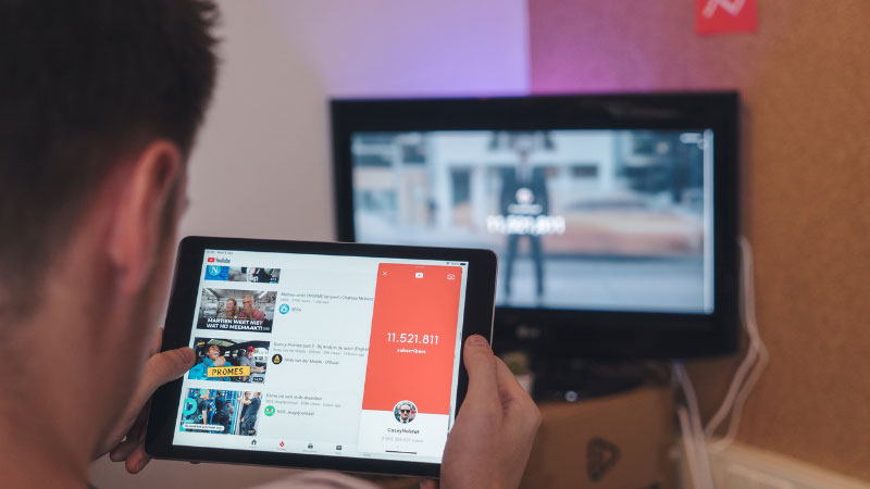 man watching youtube videos