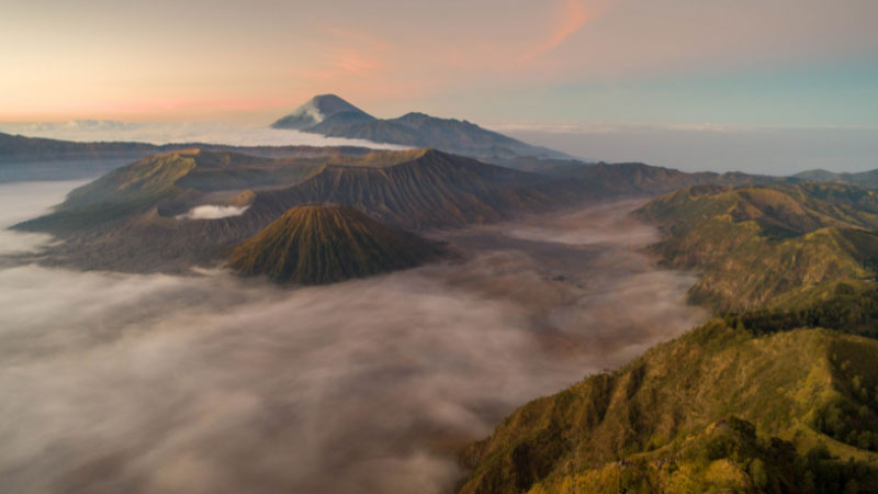 the clouds rolling over mount bromo in indonesia
