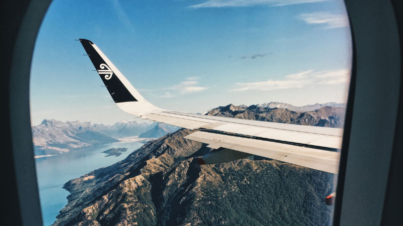 a plane flying over the mountains