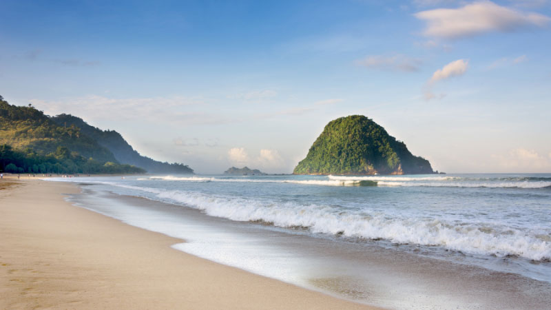 a beach on red island in java