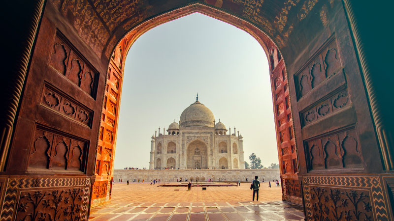 A photograph of the Taj Mahal taken from one of the gates