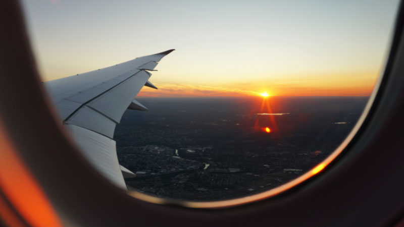 a sunset out of a plane window