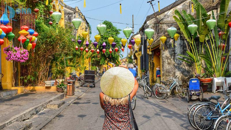 a woman exploring the city of hoi an, Vietnam