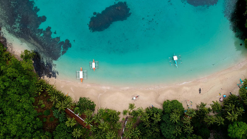 a drone shot of a beach in the philippines
