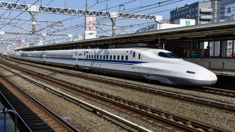 a japanese bullet train pulling into a station