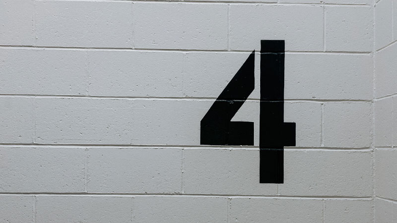 the number four painted on a wall