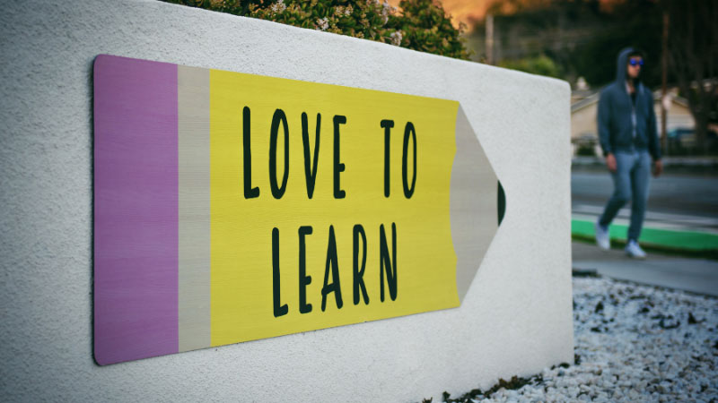 a sign that reads love to learn