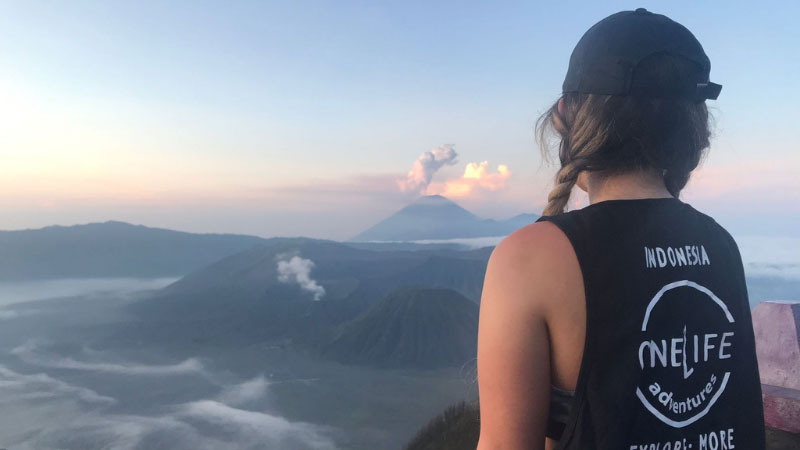 woman looking out over mount bromo
