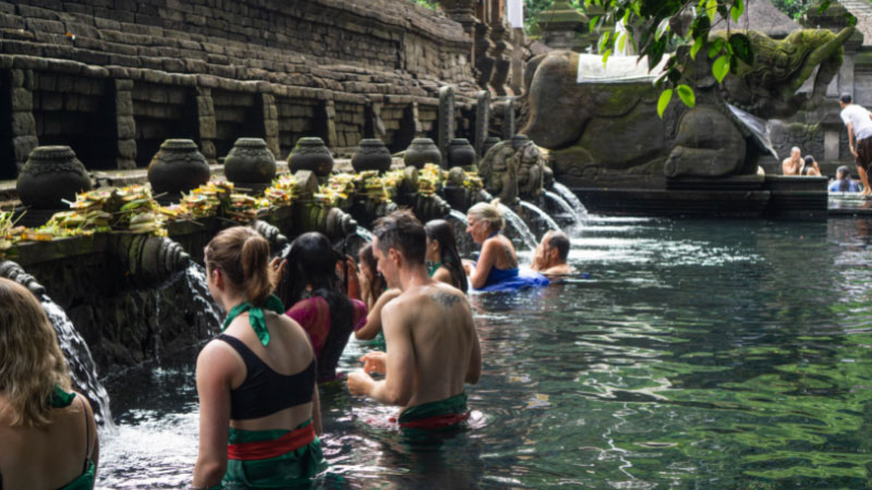 people in the holy springs of tirta empul water temple